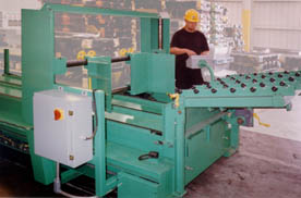 Image of worker at controls of sheet stacker